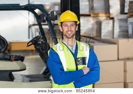 Worker wearing hard hat in warehouse in the warehouse