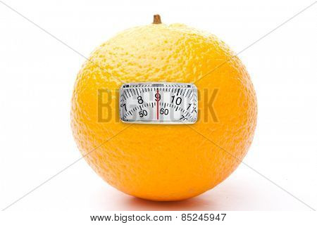 weighing scales against one orange