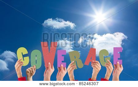Hands holding up coverage against bright blue sky with clouds