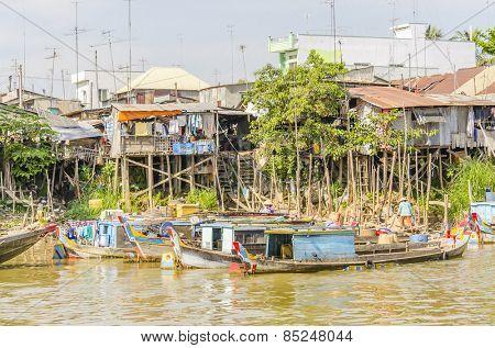 CHAU DOC, VIETNAM - JANUARY 2, 2013: Rural life in Vietnam - Floating village and fishing boats mooring at the riverside of Bassac River