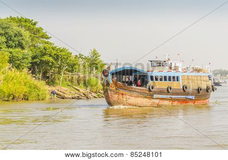 CHAU DOC, VIETNAM - JANUARY 2, 2013: Rural life in Mekong delta- Fishing boat on Bassac River