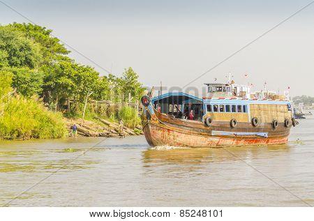 CHAU DOC, VIETNAM - JANUARY 2, 2013: Rural life in Mekong delta- Fishing boat on Bassac River
