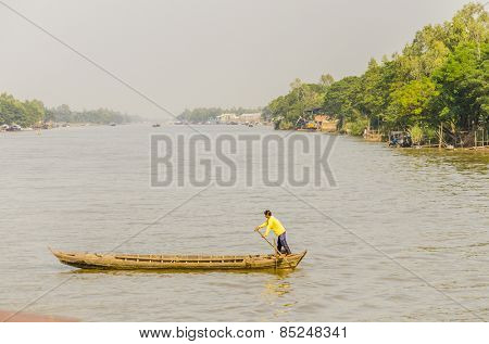 CHAU DOC, VIETNAM - JANUARY 2, 2013: Rural life in Vietnam - Local man rows the ball on Bassac River