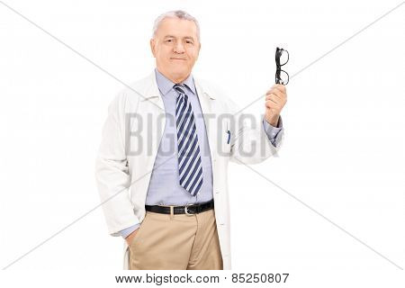 Mature doctor holding a pair of glasses isolated on white background