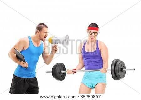 Fitness coach motivating a nerdy guy via megaphone isolated on white background