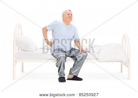Senior waking up with a pain in his back isolated on white background