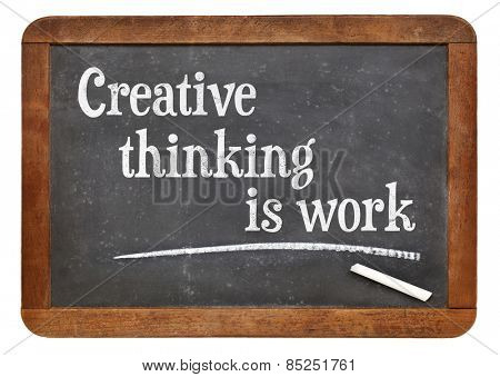 Creative thinking is work - creativity concept - text on a vintage slate blackboard