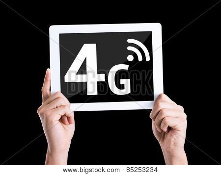 Tablet pc with text 4G isolated on black background
