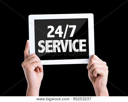 Tablet pc with text 24/7 Service isolated on black background