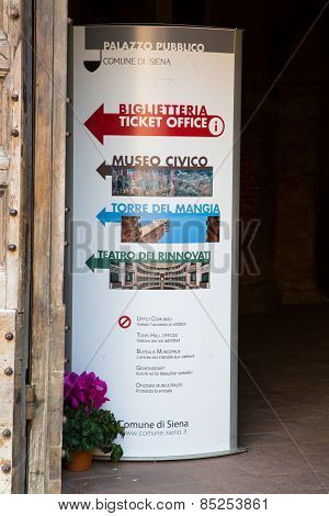 Signpost To The Ticket Office Of Torre Del Mangia In Siena, Italy