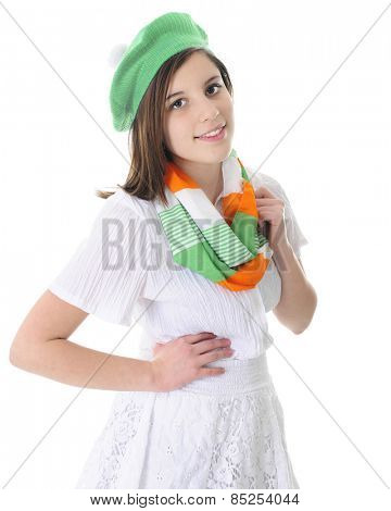 A beautiful brunette teen in white skirt and blouse, adorned with an infinity scarf and hat in green, white and orange.  On a white background.