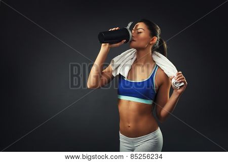 Attractive Young Woman Drinking Proteins