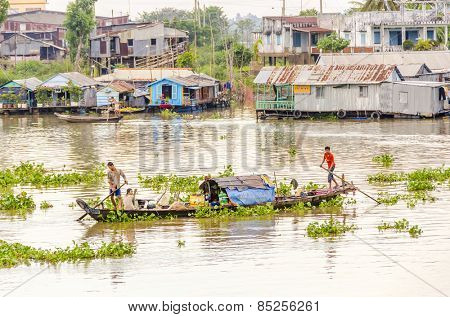 CHAU DOC, VIETNAM - JANUARY 2, 2013:  Local fishermen go back to the port on Hau River (Bassac River) in Chau Doc in Mekong Delta