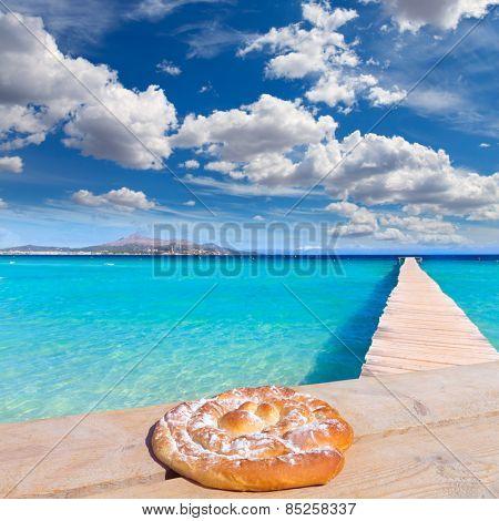 Majorca Platja de Muro beach in Alcudia bay in Mallorca ensaimada photo mount