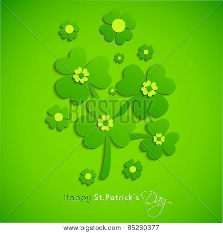 Irish lucky shamrock and clover leaves on shiny green background for Happy St. Patrick's Day celebration.