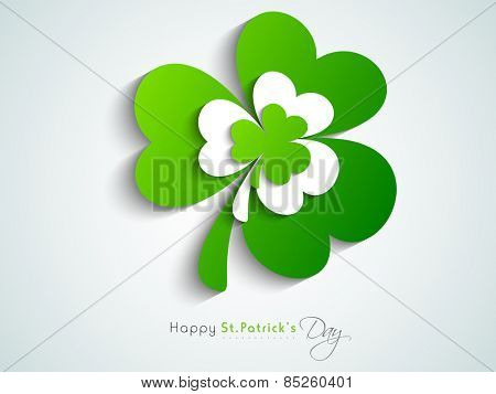 Happy St. Patrick's Day celebration with Irish lucky shamrock leaves on blue background.