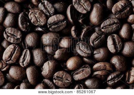 Roasted Coffee beans dark background macro close-up