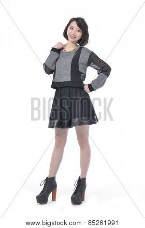 Full body elegant glamour woman walking in studio