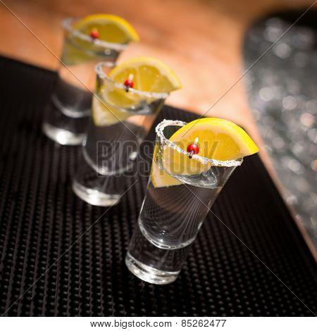 Three Tequila Shots With Lemon