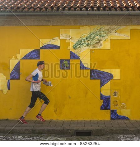 PORTO, PORTUGAL - CIRCA FEB, 2015: Portuguese azulejo tile on one of the streets of the Old Town. In 1996, UNESCO recognised Old Town of Porto as a World Heritage Site.