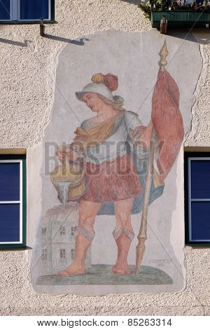 ST. GILGEN, AUSTRIA - DECEMBER 14: Saint Florian painting on the facade of the house in St. Gilgen on Wolfgang See lake, Austria on December 14, 2014.