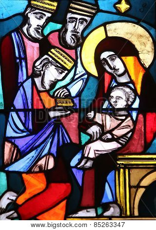 ELLWANGEN, GERMANY - MAY 07: Nativity Scene, Adoration of the Magi, stained glass window in Basilica of St. Vitus in Ellwangen, Germany on May 07, 2014.