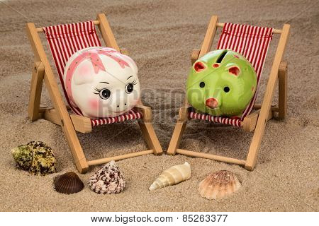 beach chair with piggy bank on the sandy beach. symbolic photo for cost of travel, vacation, holidays. save on vacation