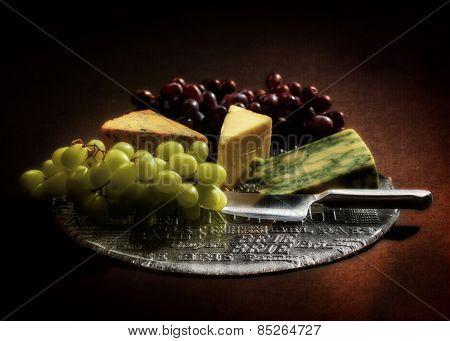 Grapes and cheese still life