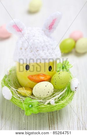 Easter decoration with little duck and eggs