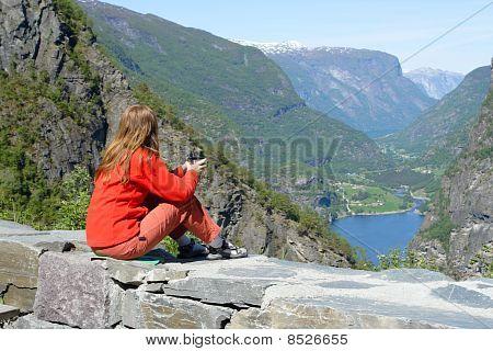 Girl On A Parapet
