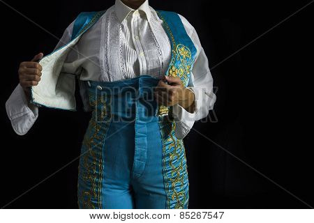 Woman Bullfighter By Dressing With Vest On A Black Background