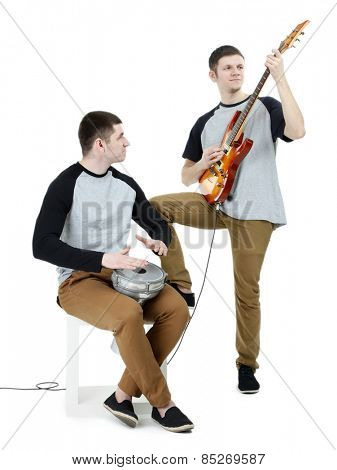 Two handsome young men with musical instruments isolated on white