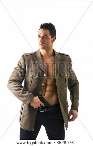 Athletic Man In Open Military Jacket Holding Gun In Pants