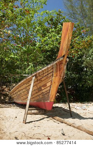 Thai Boat Is Being Repaired At Beach