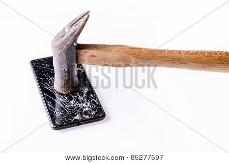 Hammer And  Smartphone With Broken Screen On White.