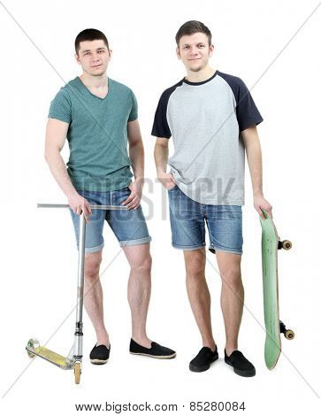 Two handsome young men with skate and scooter isolated on white
