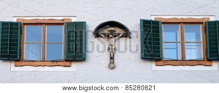 ST. WOLFGANG, AUSTRIA - DECEMBER 14: Crucifixion on house facade in St. Wolfgang on Wolfgangsee in Austria on December 14, 2014.