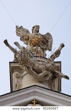 GRAZ, AUSTRIA - JANUARY 10, 2015: The Fall of the Angels, portal of Mariahilf church in Graz, Styria, Austria on January 10, 2015.