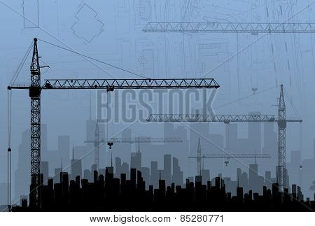 Construction Cranes On The Background Buildings