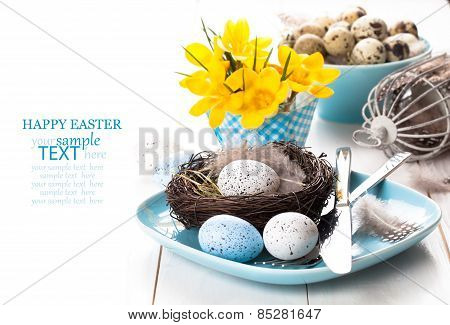 Easter Eggs Nest On Plate With Yellow Spring Crocus. On White Wooden Background