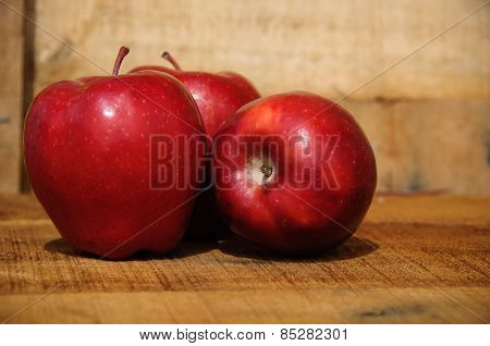 Fresh red apples on wooden background, Healthy fruit background.