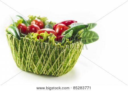 different vegetables in green basket