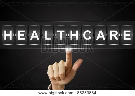 Business Hand Clicking Healthcare On Flipboard