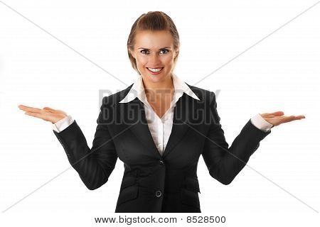 smiling modern business woman presenting something on empty hands isolated on white