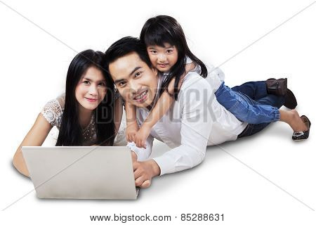 Attractive Family With Laptop In The Studio