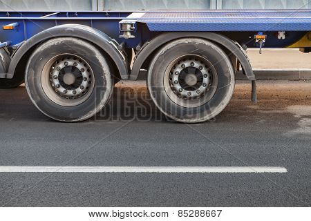 Fragment Of Big Truck, Wheels On Dark Asphalt Road