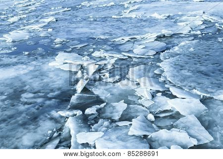 Big Ice Fragments Covered With Show On Frozen River
