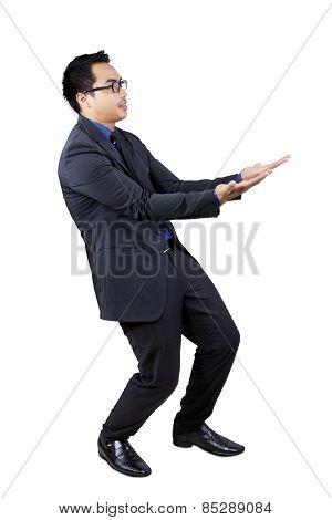 Businessman Carrying Something In Studio