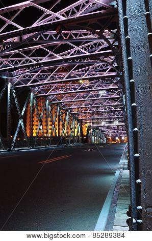Night scene of colourful Waibaidu Bridge