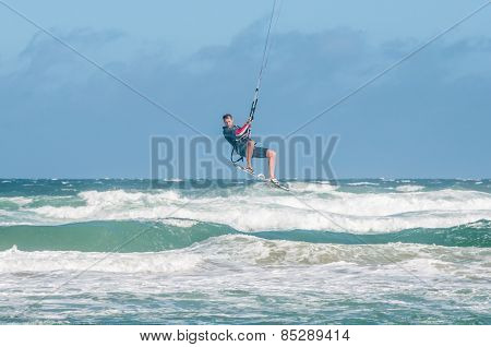 Windsurfer High Above The Waves